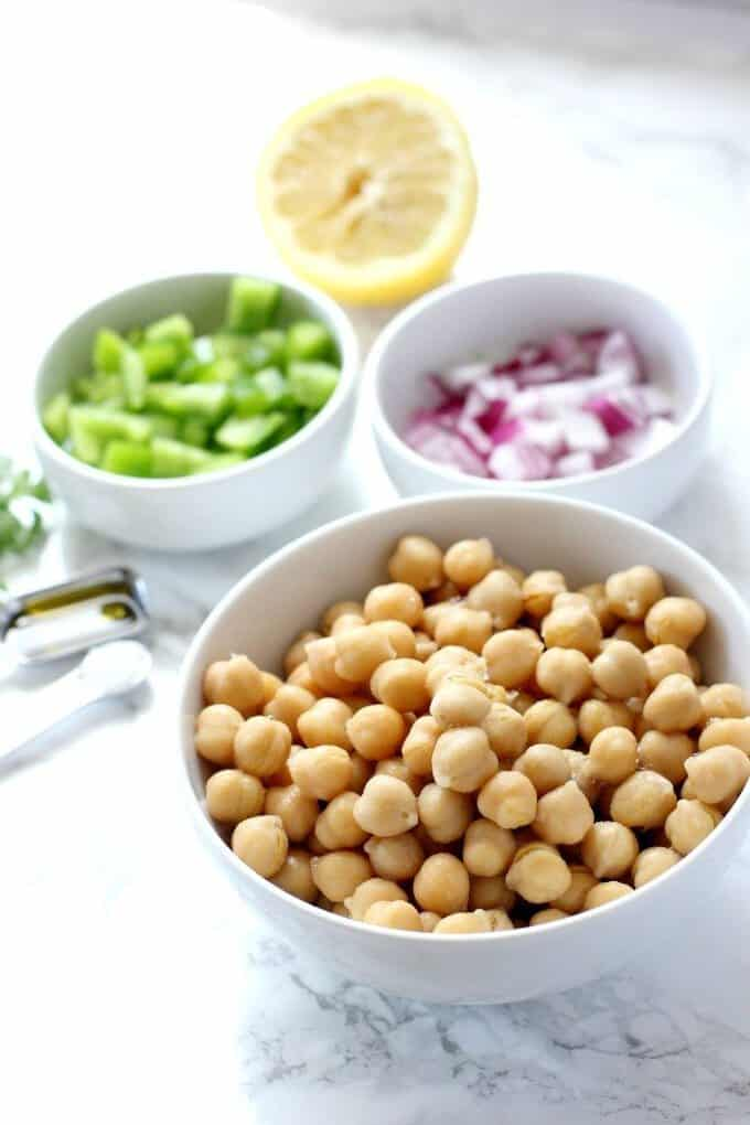 chickpea salad ingredients in bowls