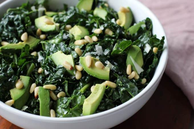 kale salad with avocado in a bowl
