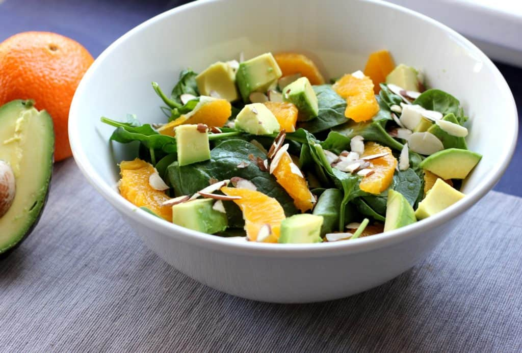The creamy avocado and sweet orange slices give this spinach salad a wonderful flavor! It's an easy weeknight side dish!