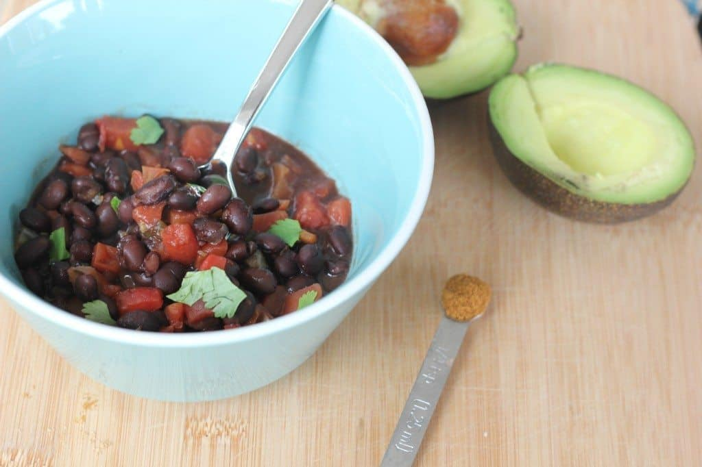 vegetarian black bean soup in a blue bowl