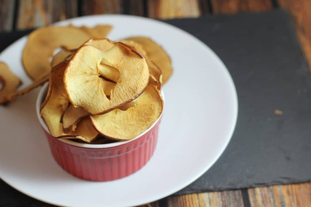This healthy baked apple chip recipe is almost too easy! You can make these in the oven and have a sweet & crunchy snack!