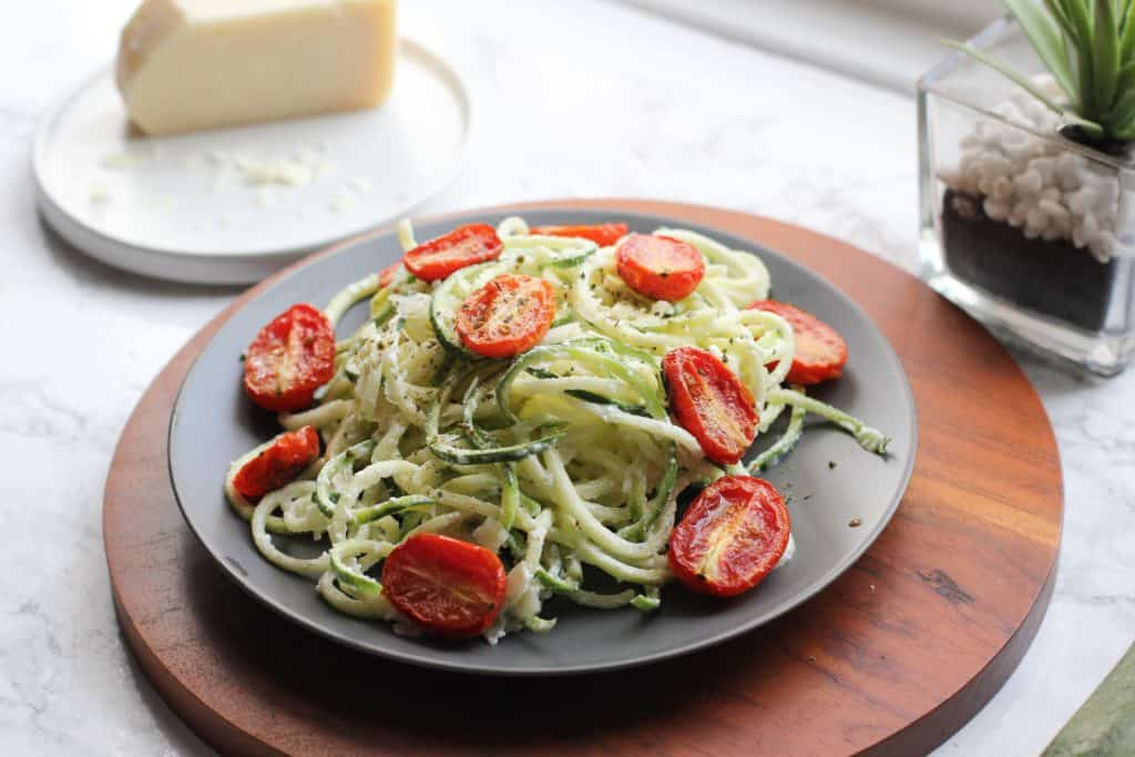 zucchini noodles and tomatoes on a plate