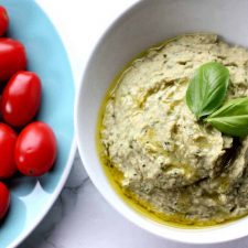 This basil pesto hummus recipe is a Zoe's Kitchen Copycat! It''s perfect with raw veggies & pita or on top of a salad!