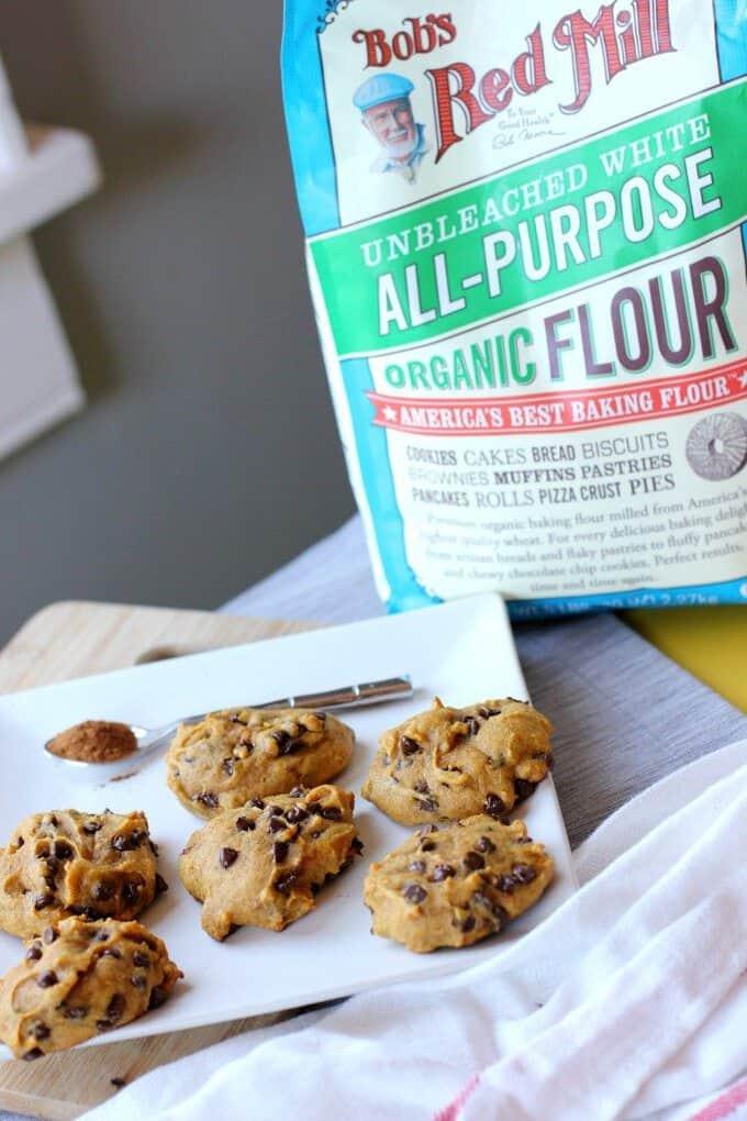 Pumpkin cookies next to the flour