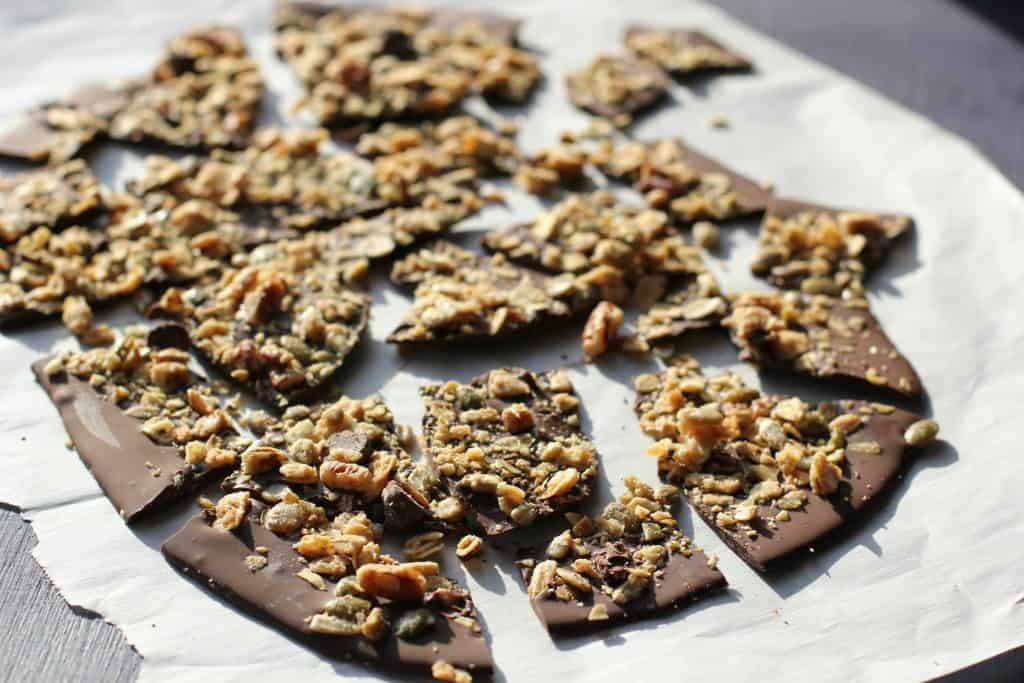 granola bark on a piece of baking paper