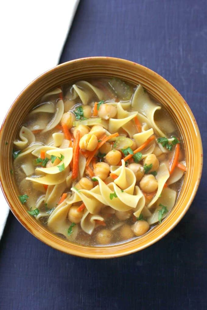 This chickpea noodle soup is a vegetarian comfort food that can be ready in 30 minutes or less. It's perfect for a weeknight meatless meal!