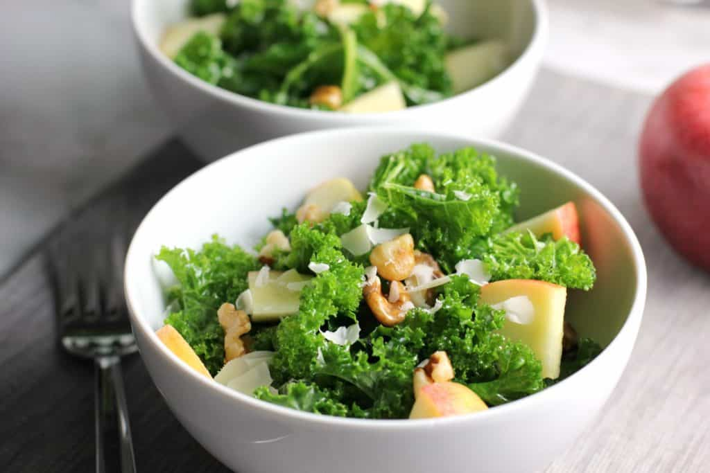kale salad in a white bowl