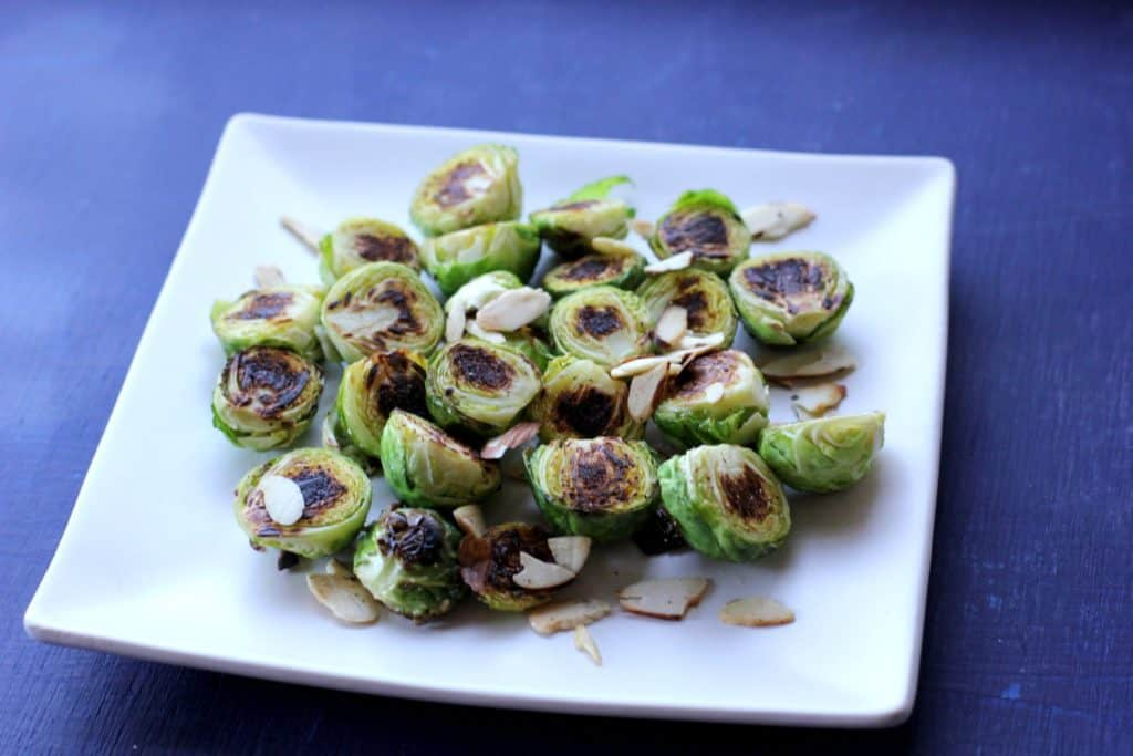 These stovetop brussels sprouts are a quick and easy way to add a healthy side dish to any meal! The Brussels Sprouts are cooked until brown and crispy and the almonds add a delicious crunch!