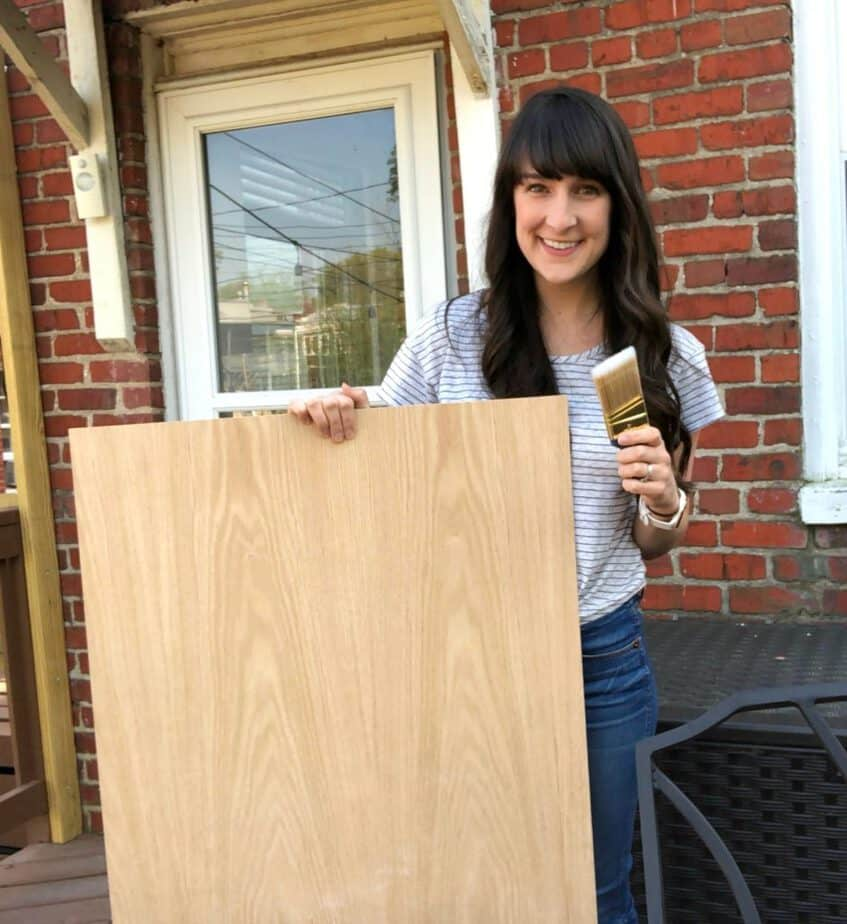 me holding plywood