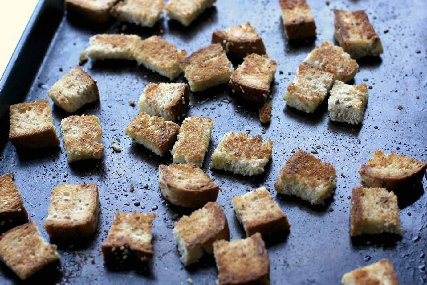 whole wheat croutons on a pan