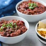 vegan chili in a bowl with chips