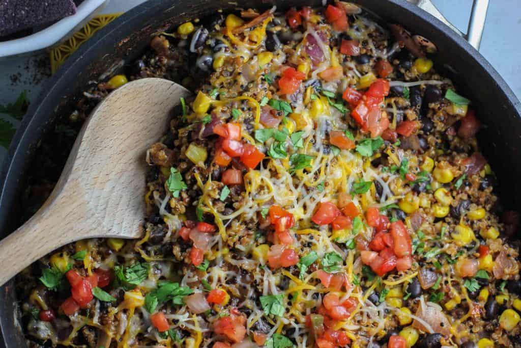 Stirring quinoa Taco Skillet