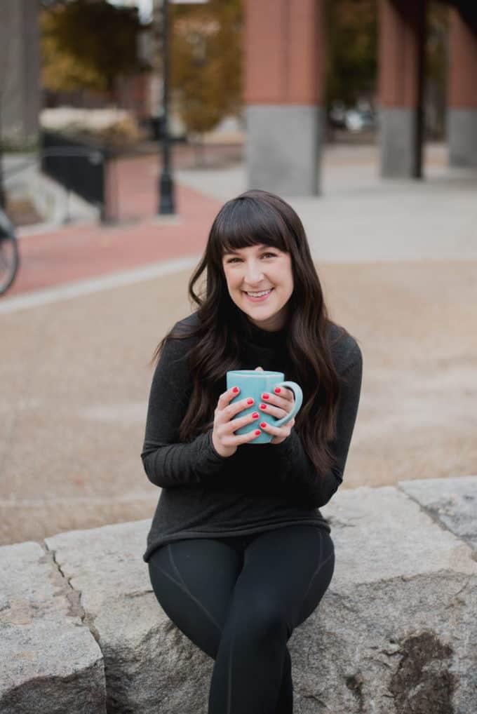 me holding coffee