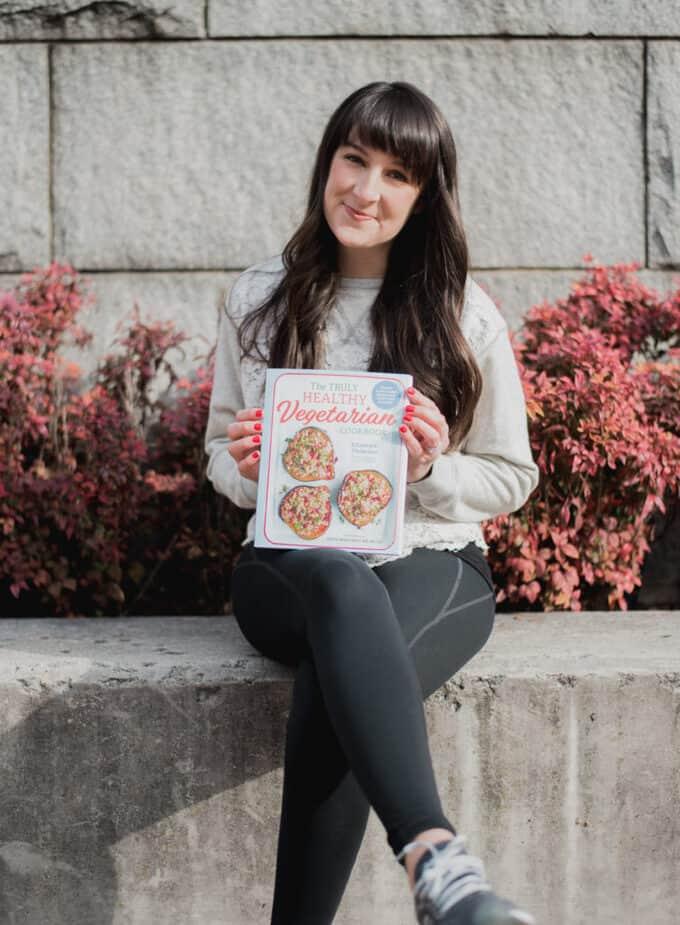 me holding my cookbook