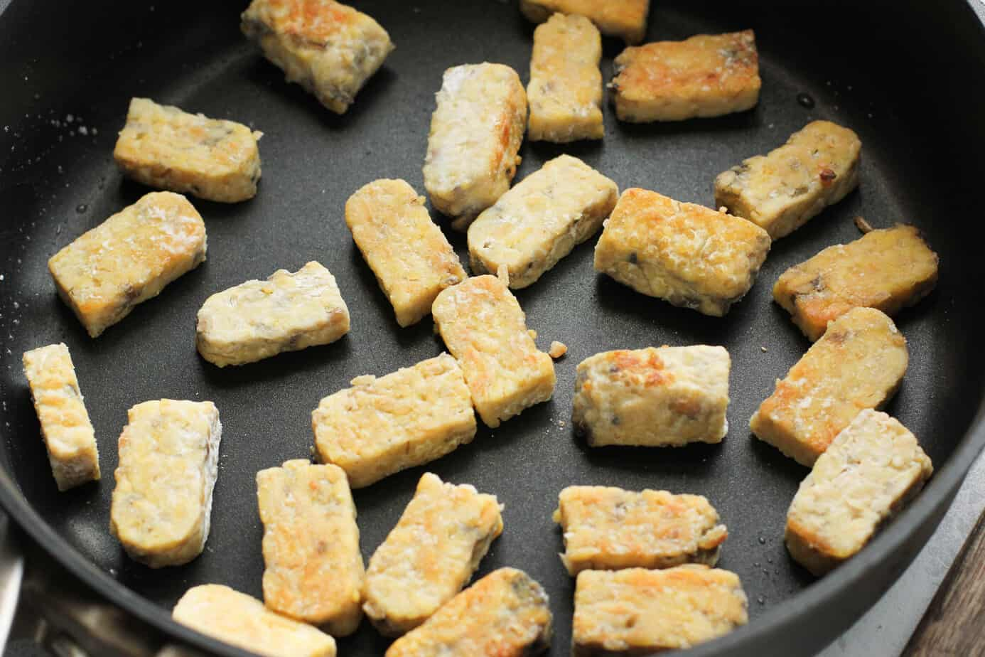 tempeh cooking in a pan