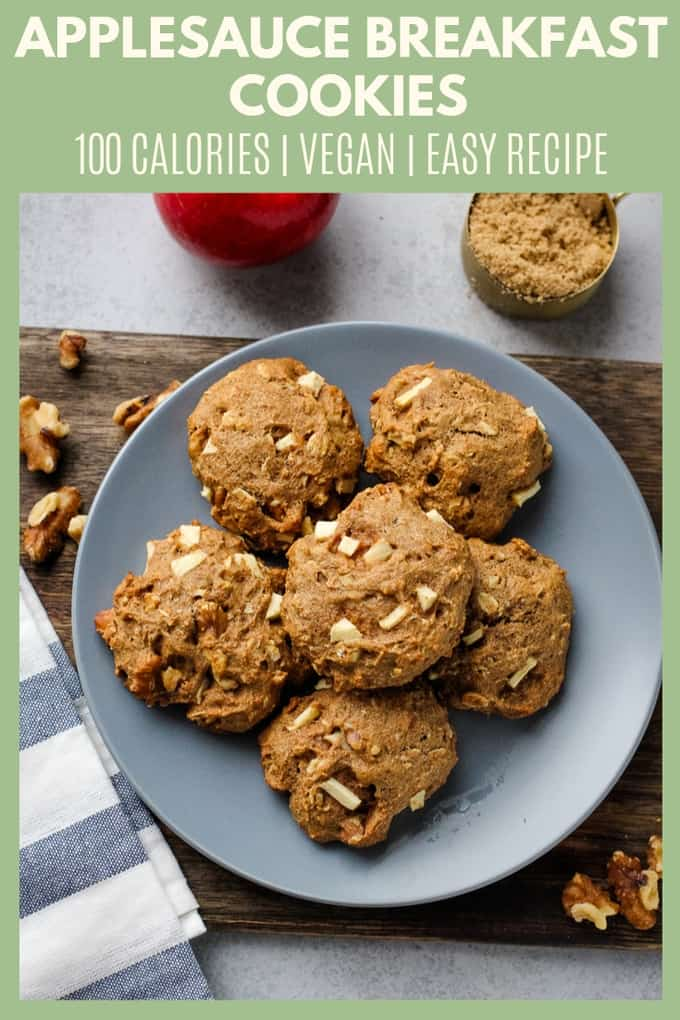 These applesauce cookies are made with whole wheat flour, rolled oats, and diced apples for a treat that is healthy enough for breakfast! Each cookie has less than 100 calories, so it\'s perfect when you need a little something sweet!