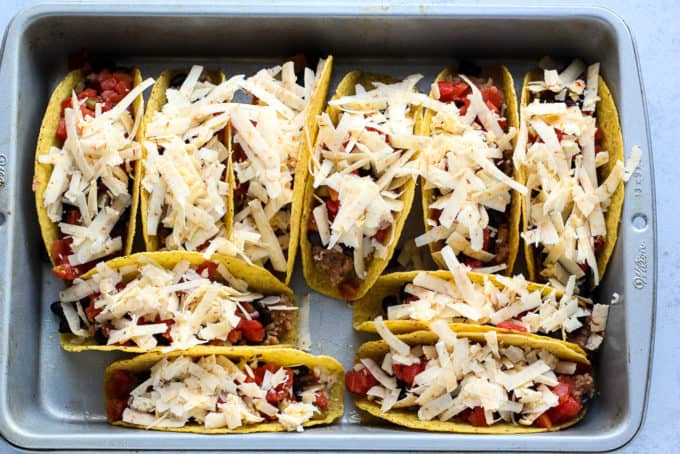 tacos in a pan before baking