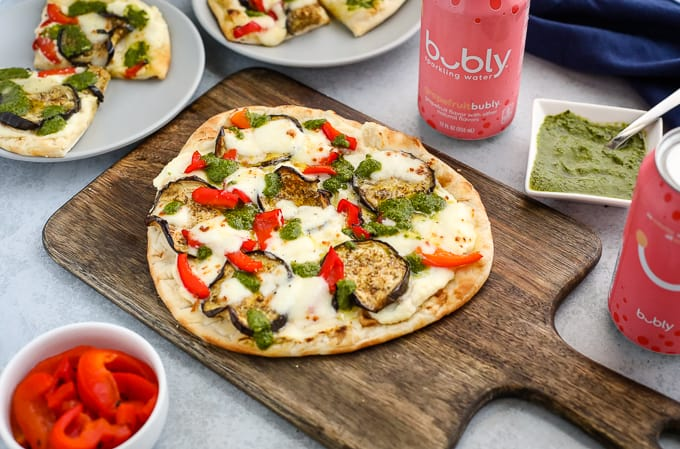 naan pizza on a cutting board