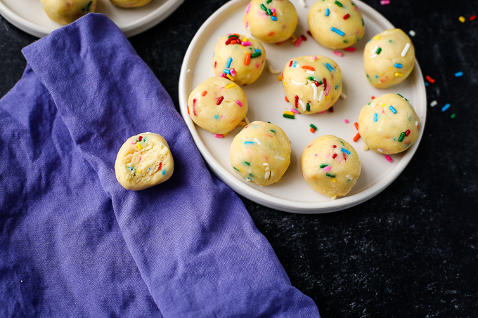 cake batter truffles on a plate with sprinkles