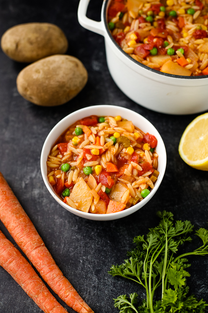 orzo vegetable soup in a bowl
