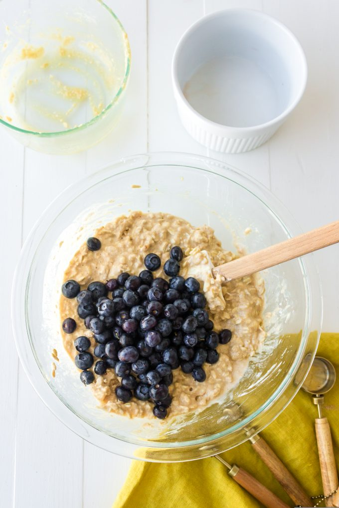 blueberries being stirred into muffin batter