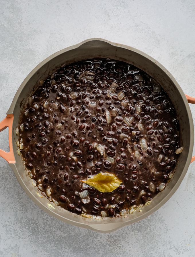 black beans cooking in a skillet