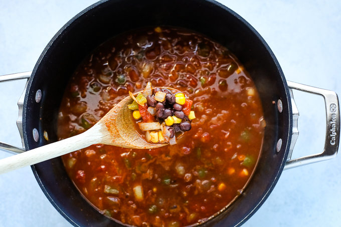 enchilada soup ingredients in a pot