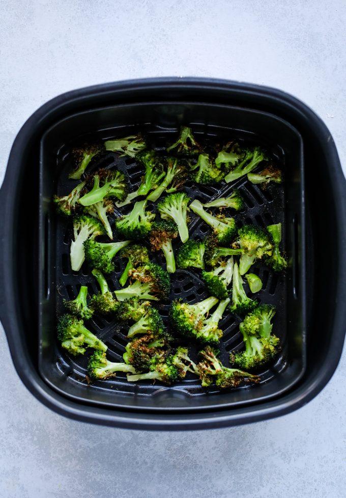 broccoli in an air fryer basket