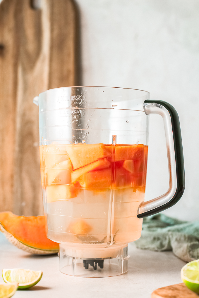 fruit and water in a blender
