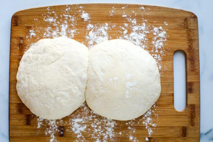 risen dough on a cutting board