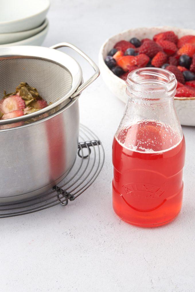 strained strawberry strup in a jar