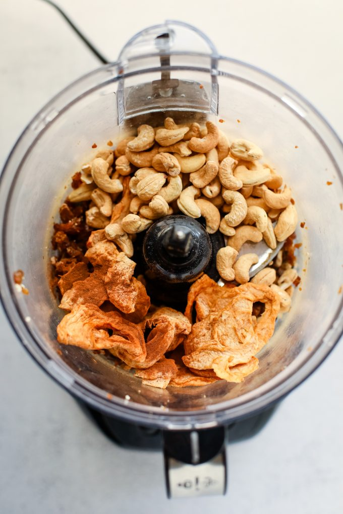nuts, dates, and dried apples in a food processor