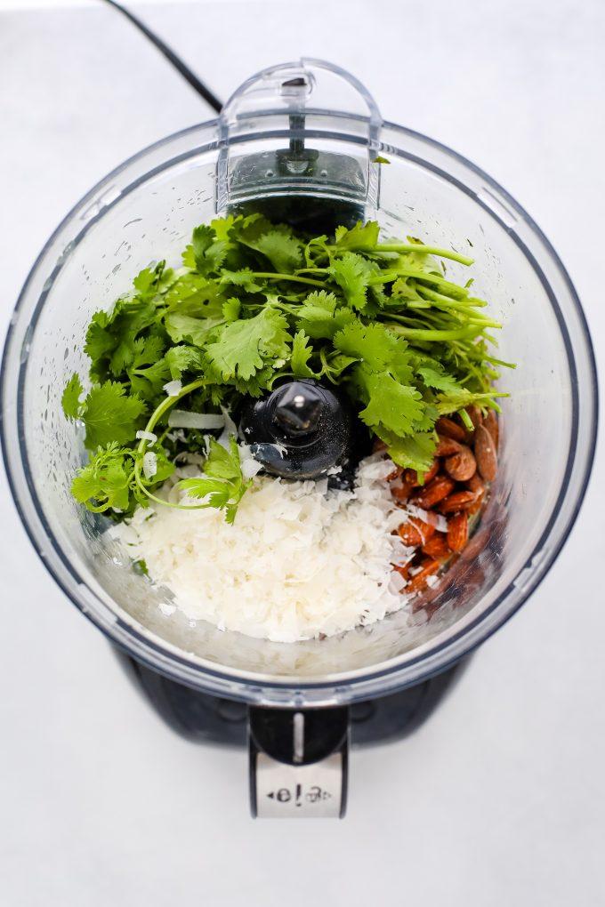 cilantro pesto ingredients in a food processor